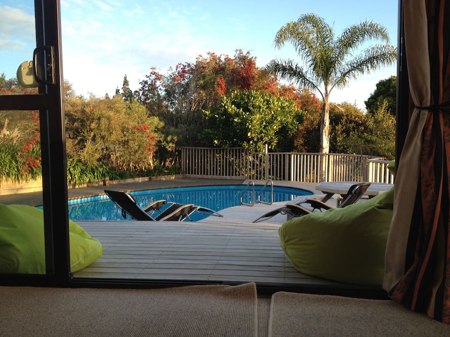 Lounge opens directly onto deck and pool area.
