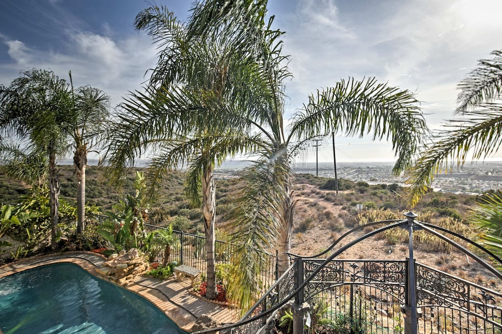 Ideally located near the beach, this home boasts a landscaped yard of fruit trees, flowers, and palm trees.