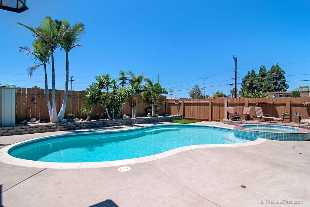 Nice size Backyard with Salt Water pool and jacuzzi.  Solar heated warm pool, electric spa heats up quickly & all controlled via smart phone.