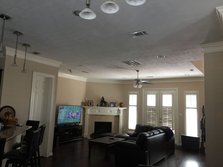 """spacious well appointed living area with a 65"""" tv"""