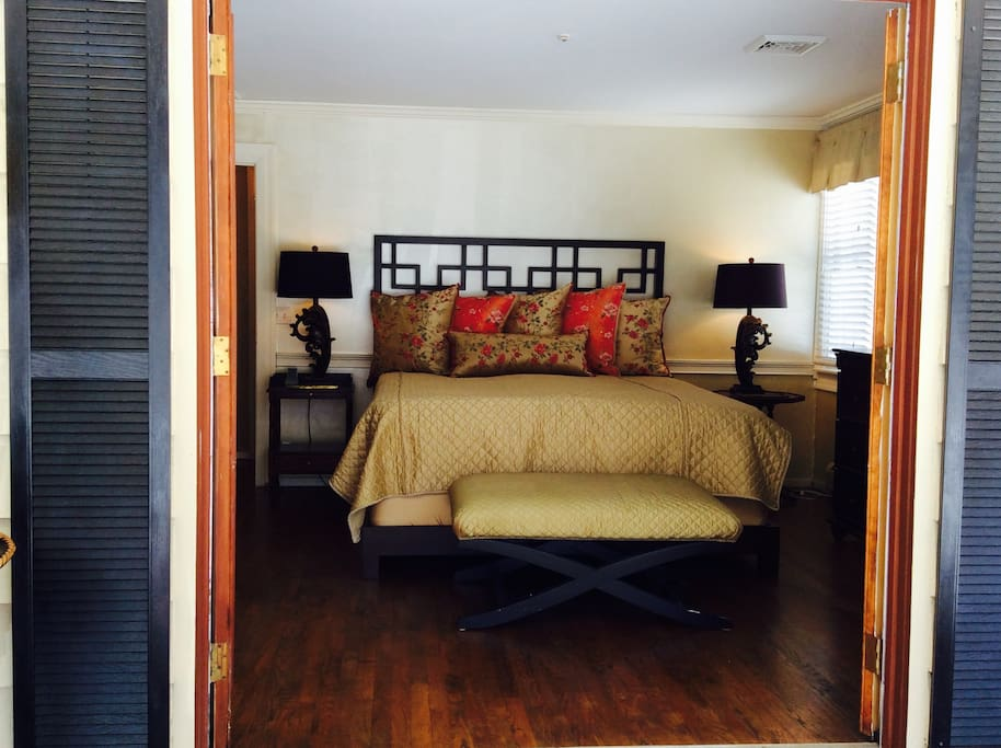 Master bedroom with kingbed.  French doors open onto secure screened porch.