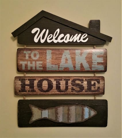 We have this in our entry to greet our guest! We truly live lake life!