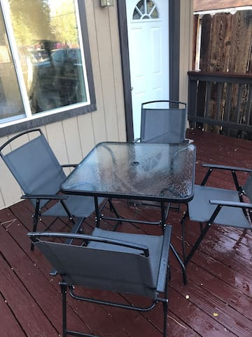 4 patio chairs and a patio table.