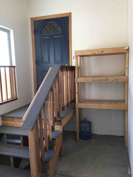 Apartment indoor entry.  Can be used for storage of sports equipment.