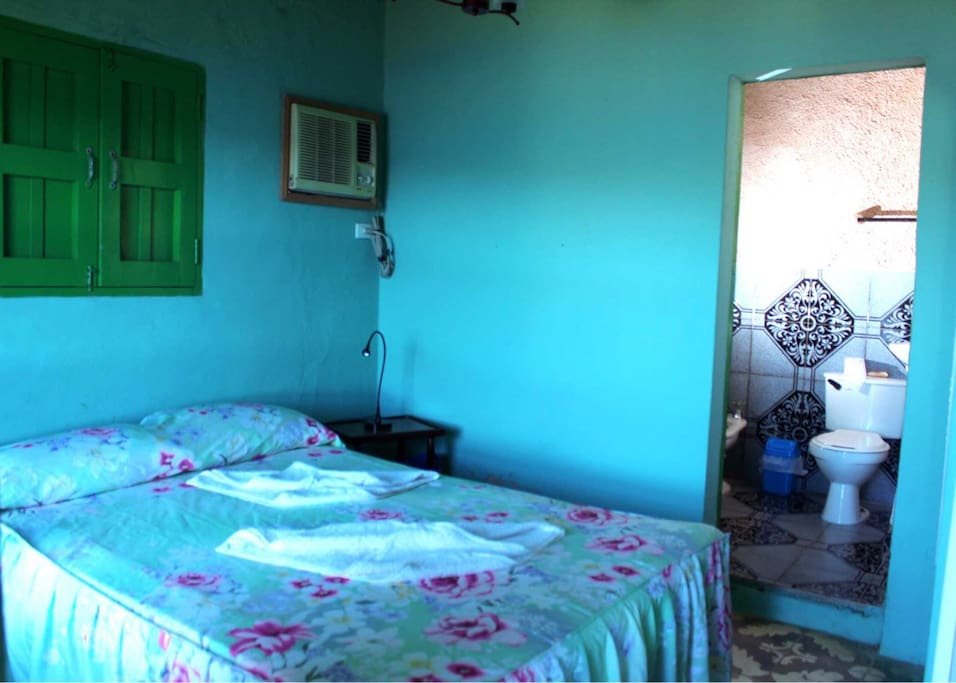 Bedroom with double bed and private bathroom