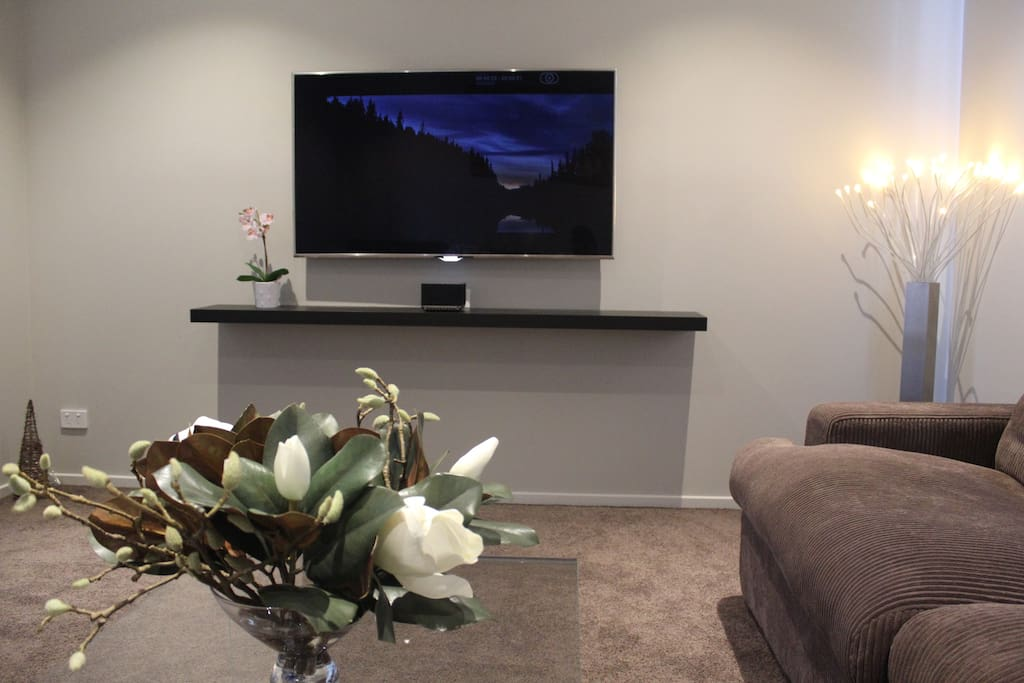 "Comfy Theatre room featuring a 65'' SUHD LED TV, 4K Netflix and Foxtel HD and cutting edge ""Mass Fidelity Core"" audio system"