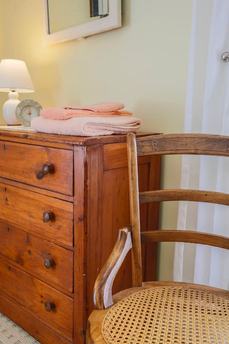 Antiques furnishings are in keeping with time period of the house built in 1855