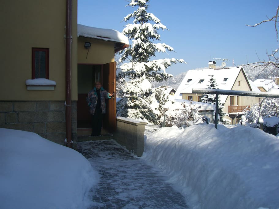 Owner Zenka in the house entrance on a wintry day in January