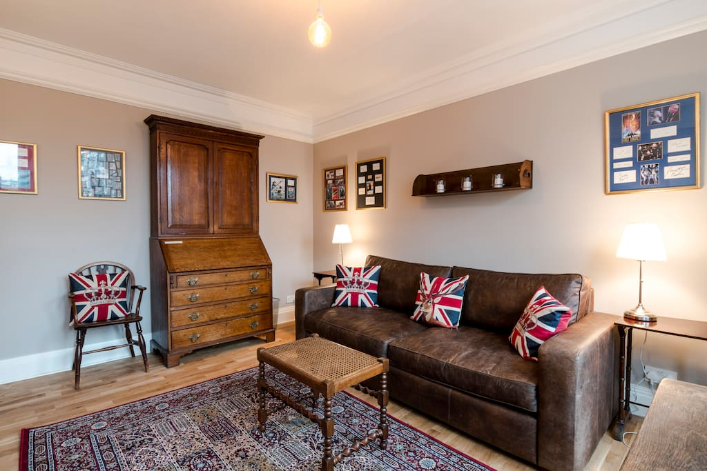 "Light, airy, super-comfortable, relaxing and elegant lounge, featuring made-to-measure leather sofa-bed, antique bureau, Art Nouveau fireplace, double-glazing and 50"" plasma HDTV."