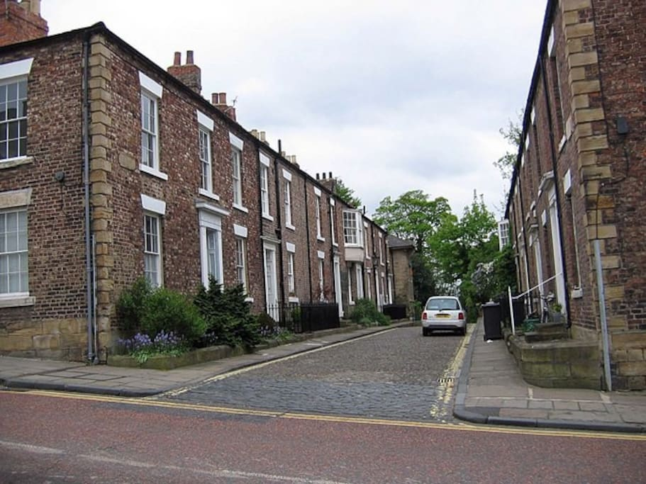 The house is at the end of the street on the left