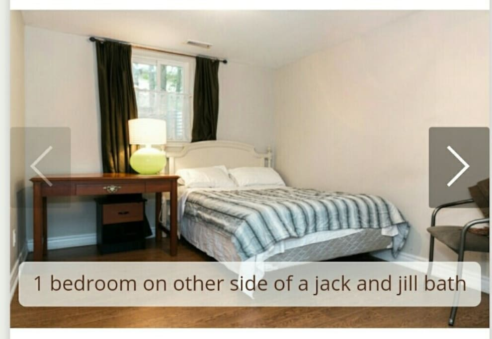 Queen bed that opens on small den and shares bathroom with second bedroom.  Firmest queen mattress.