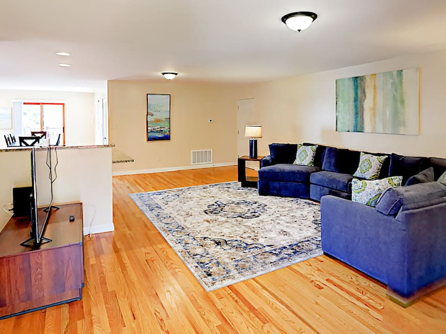 A plush sectional and hardwood floors vitalize the living room