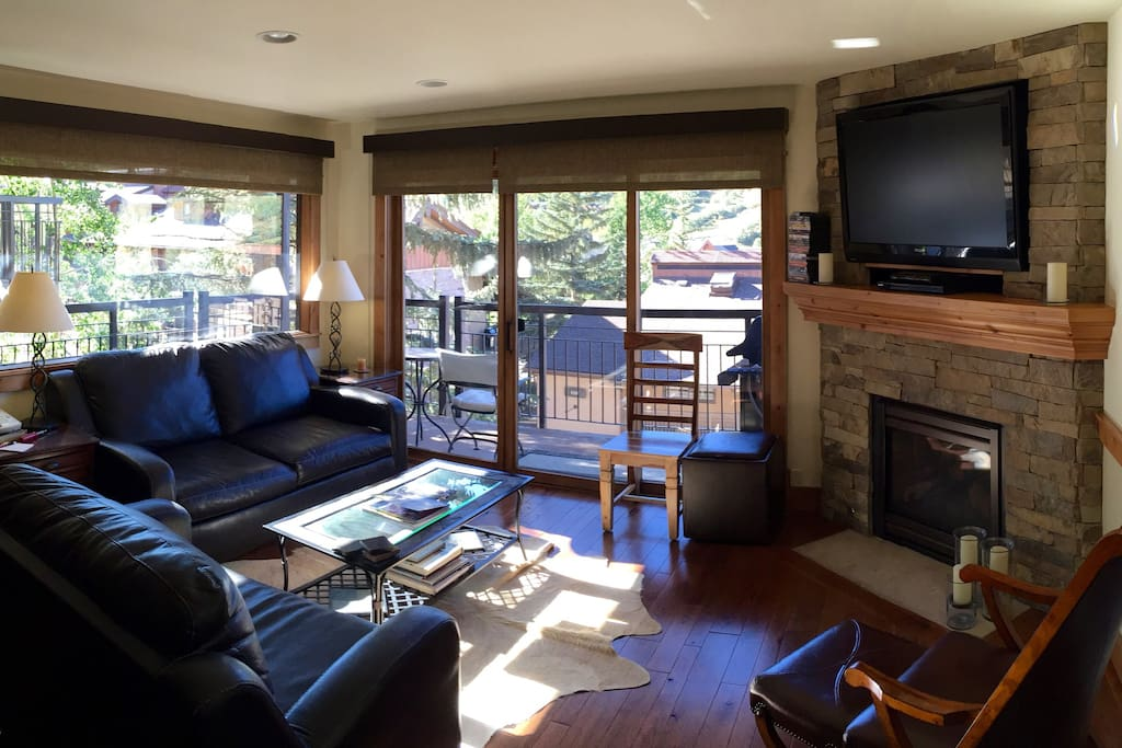 "Living room with Wrap-Around Balcony, Gas Fireplace and 52"" HDTV"