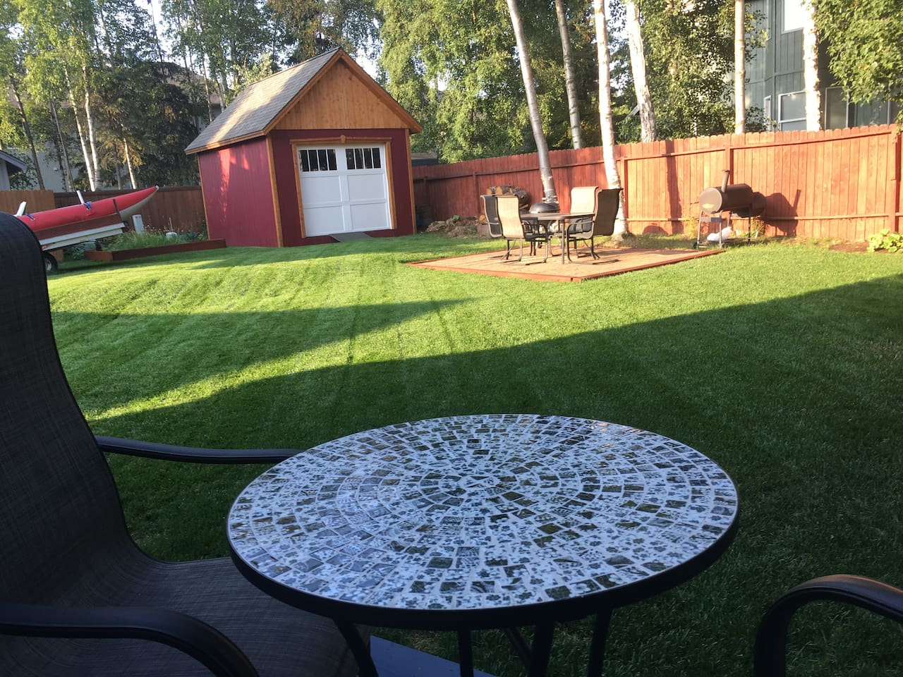 Bistro set on back deck, 18' x 20' furnished patio in back for evening sunny barbecues.