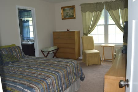 Queen Bed - room for a roll away. Two chairs to sit and look out the window.