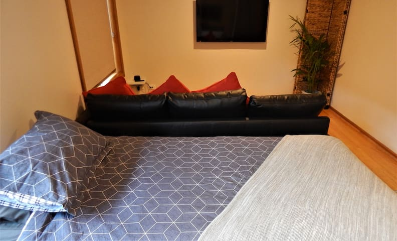 Third bedroom, 2 king single beds that convert to a king-size bed and second lounge area