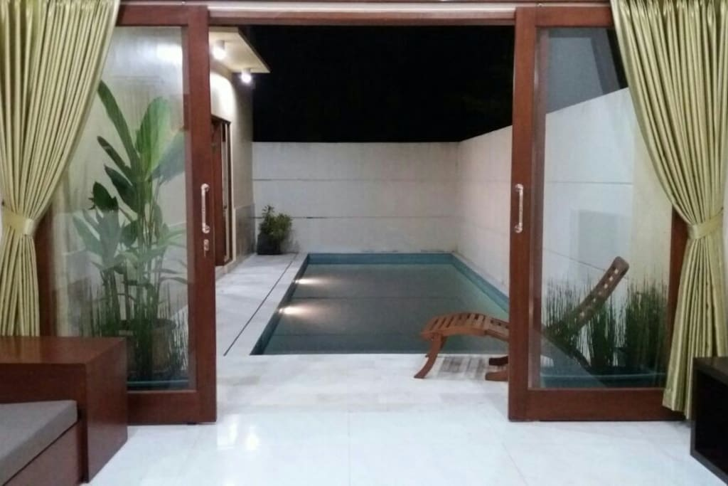 Private pool connected with living room and bedroom