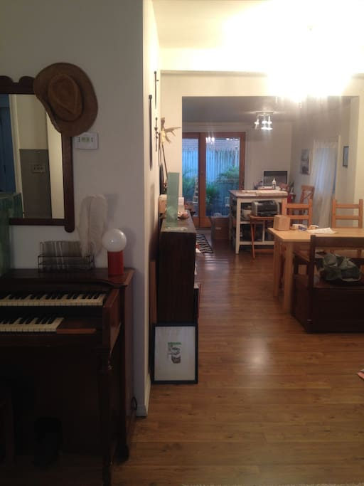 A sliver of the living room. But you'll see a table area and then a breakfast nook in the very back. The piano is out for repairs...