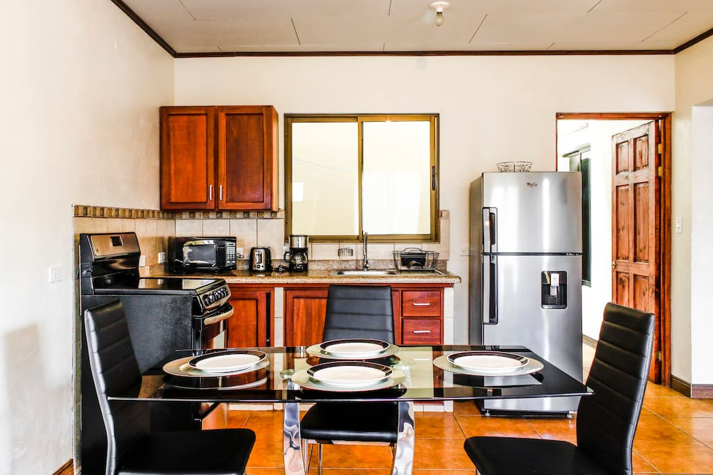 Fully functional kitchen and dining area.
