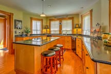 The kitchen boasts top quality appliances and a spacious center island.