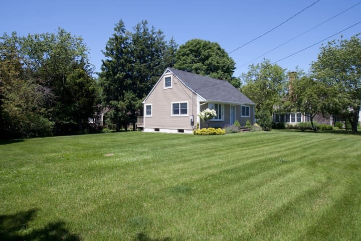 Home is located on large grassy lawns with plenty of space for play