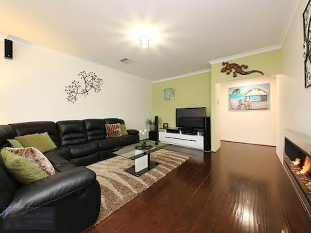 Living Area - PlayStation 3 + Games, Recliner Chairs, TV, Surround Sound, Ethanol Fire