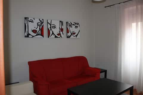 salon con dos sofas y television