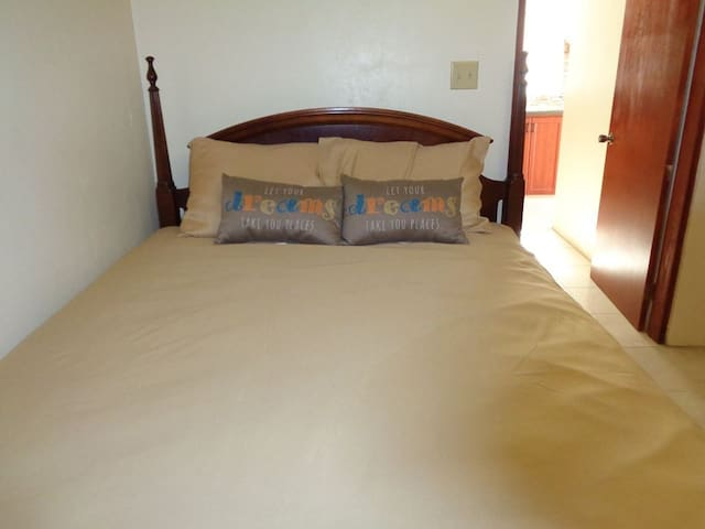 Relax on a Queen Size bed in a fully air conditioned room