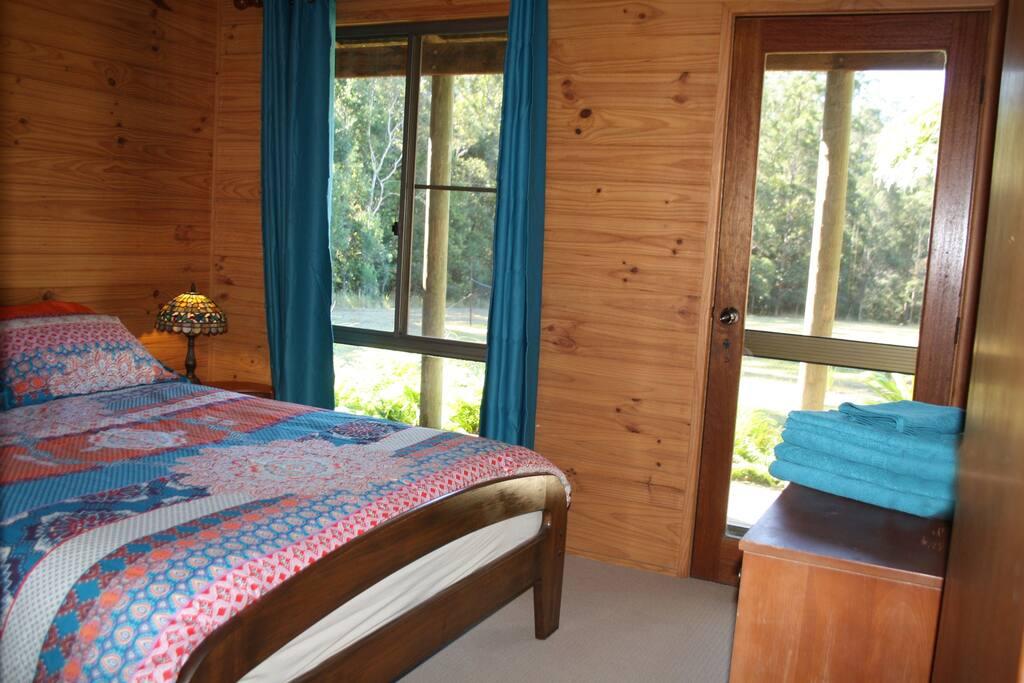 Master queen bedroom with deck access