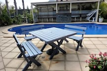 Poolside table and benches