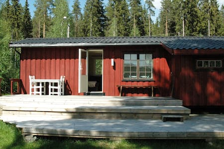 Sommerhuset. Cabin by the lake.