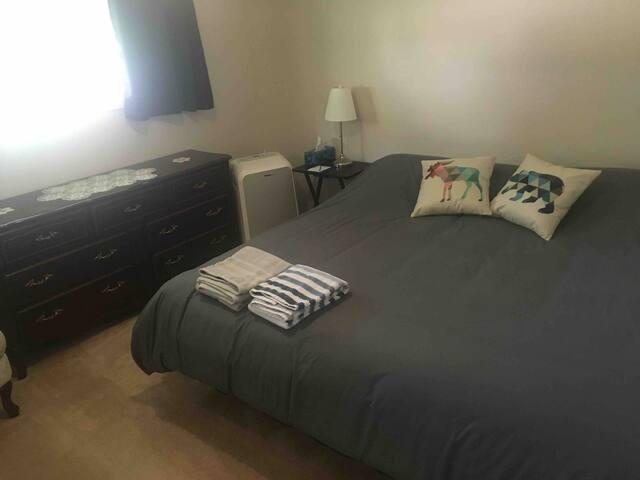 Bright master bedroom in central Rocky