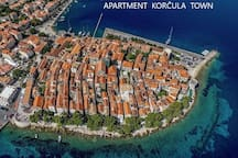 Seagull view of Korcula Old Town, the Apartment Korcula Town in the middle, next to the Bishop treasury Museum and  Cathedral.