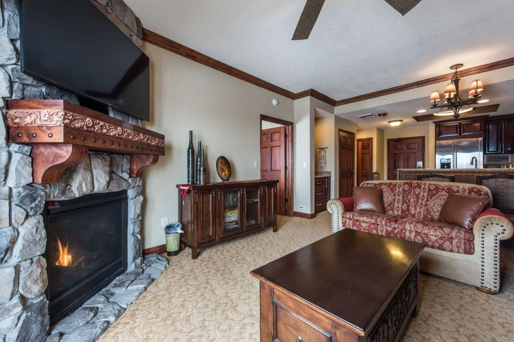 Living area is well equipped with a fireplace, 55 inch television.