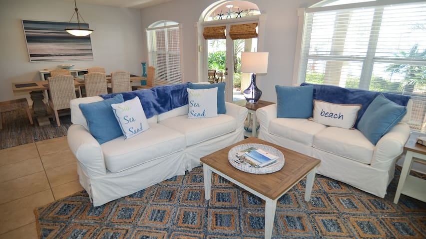 Open concept living, dining & kitchen areas offer ample room for guests