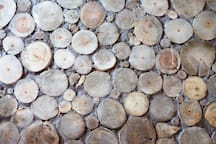 Cordwood floor took over 1200 rounds & countless hours of cutting, gluing, & grouting