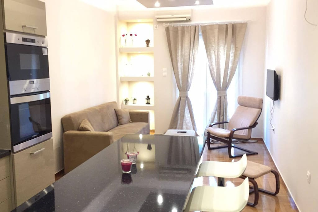 Living room & eating area just renovated in March 2017! Flat screen tv, balcony...
