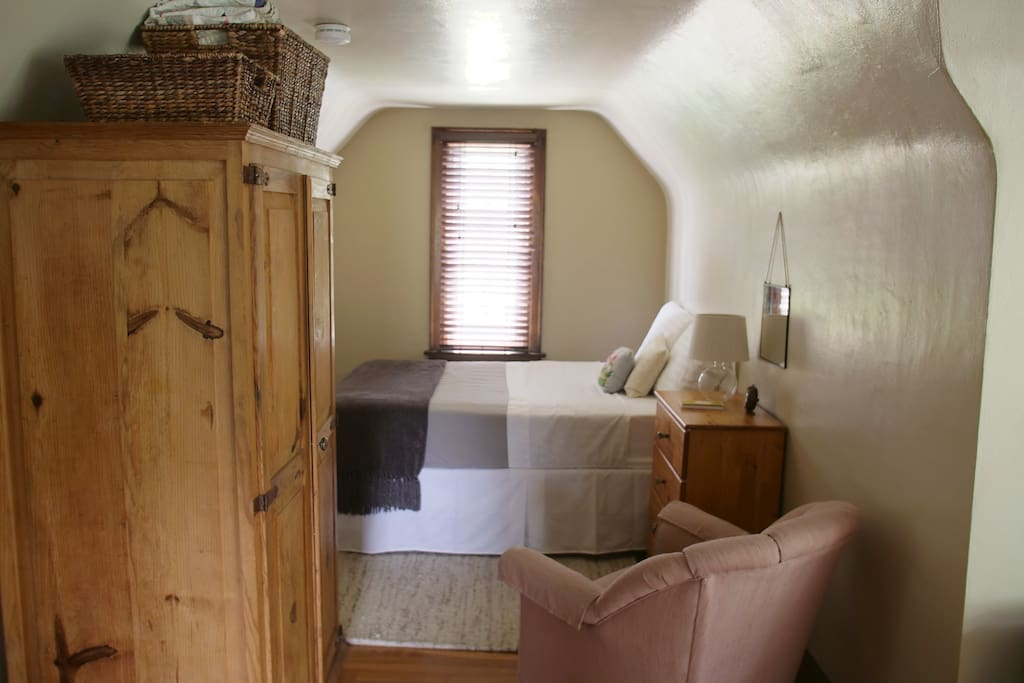 Bedroom area w/armoire and dresser for your belongings