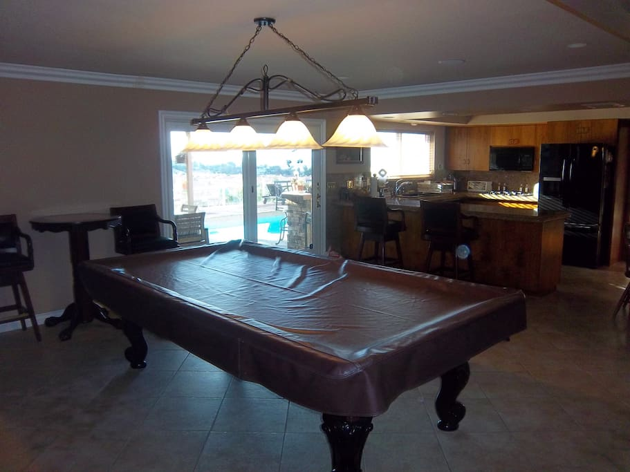 Pool table room, just off the kitchen.