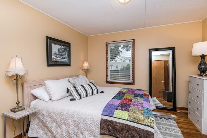 Main floor master bedroom is cozy bright and cheery