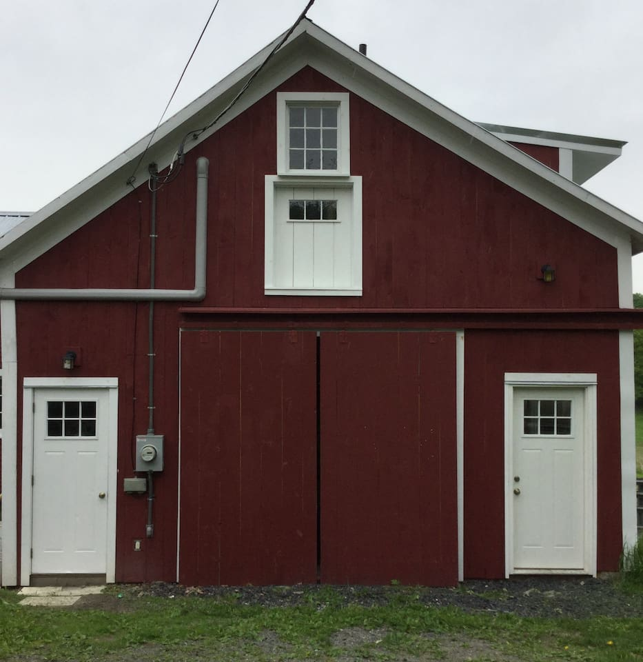 Front view of the renovated barn, entrance door is on the left.
