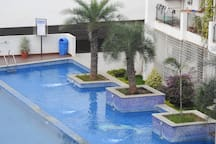 A lush blue swimming pool to rejuvenate after a tiring day!