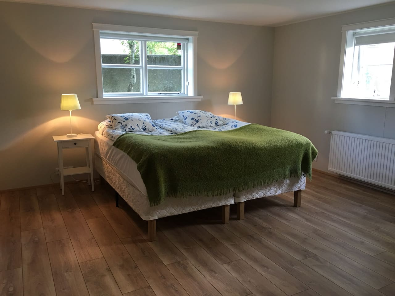 Bright and roomy bedroom with three windows