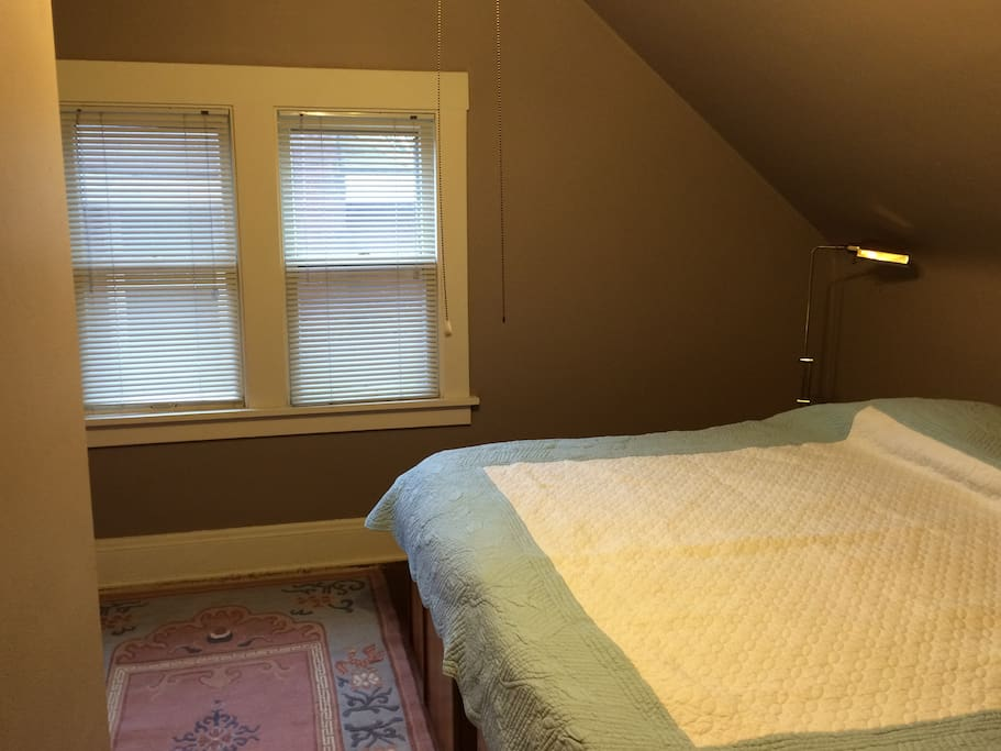 One bedroom features a king sized bed with in-frame drawers for storage.