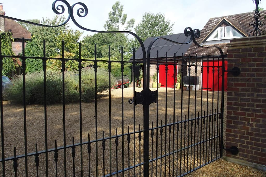 Gated entrance from our lane. The Bothy is on the right. Our house is adjacent. Ample secure parking. drive.