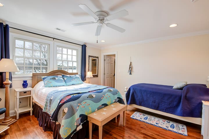 Queen and twin bed with a HUGE walk-in closet and a full bathroom attached.