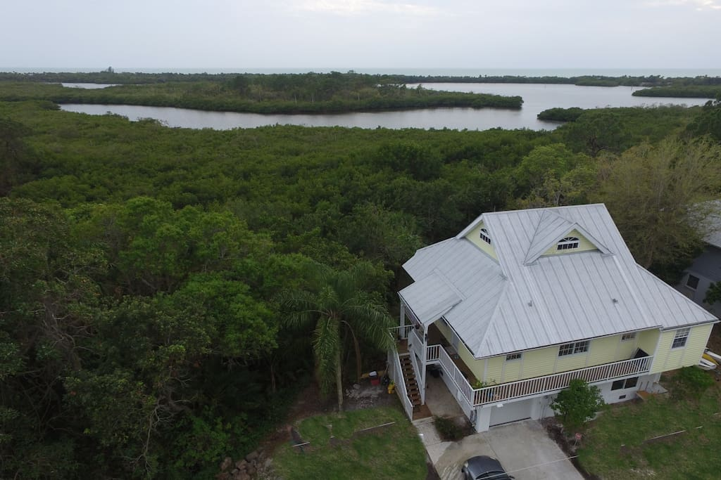 Aerial with our house and the mexican gulf in the background