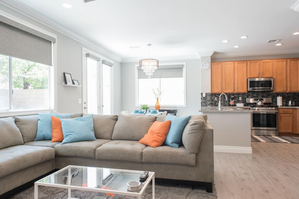 Imagine unwinding and discussing the days adventures with friends and family in this cozy living room that includes a sectional sofa and smart TV.