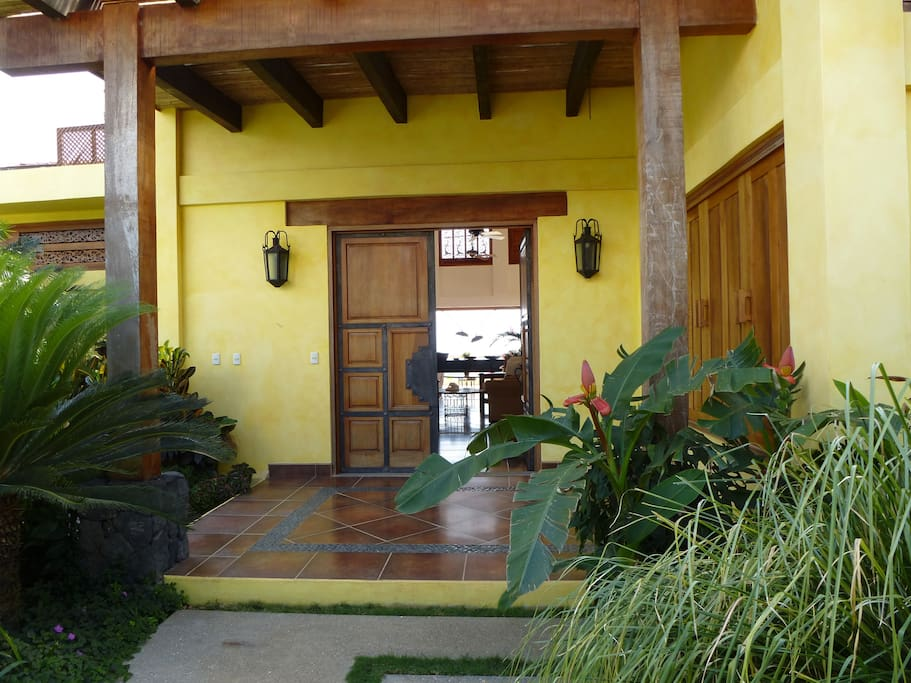 Entrance to main house thru lush tropical gardens.