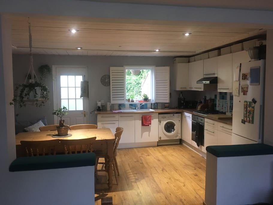 Kitchen with large fridge/freezer, washer/dryer, kettle, toaster, coffee machine